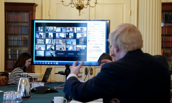 Boris Johnson, UK Prime Minister in front of a screen with Zoom open