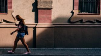 woman walking with phone