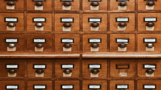 wooden drawers of paper archives