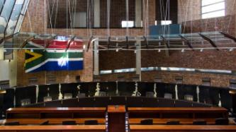 A courtroom and a flag of South Africa